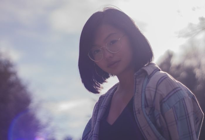 portrait photo of a girl with lens flare
