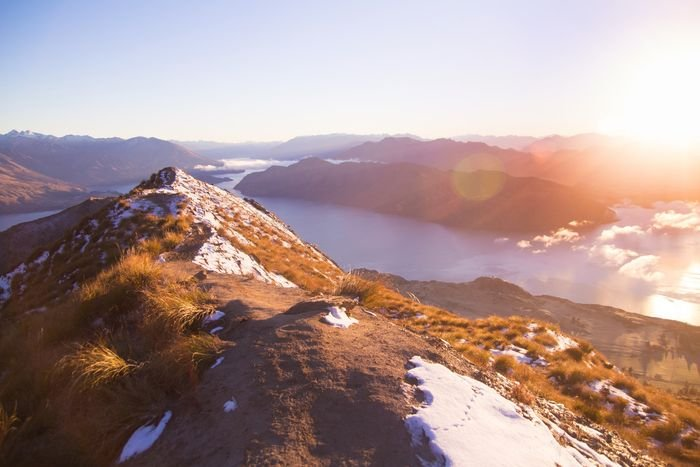 photo of a mountain range with lens flare