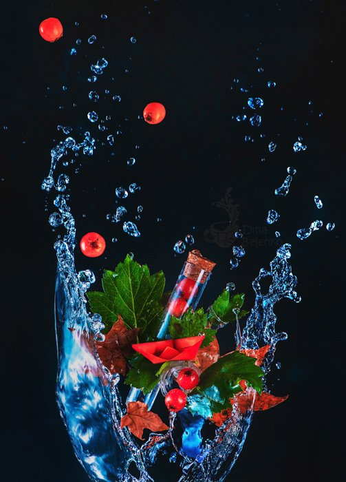 Create food photography shot of berries and water splash