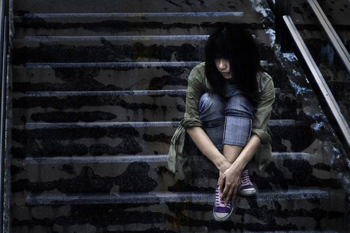 A dark and mood portrait of a female model - grunge photography tips