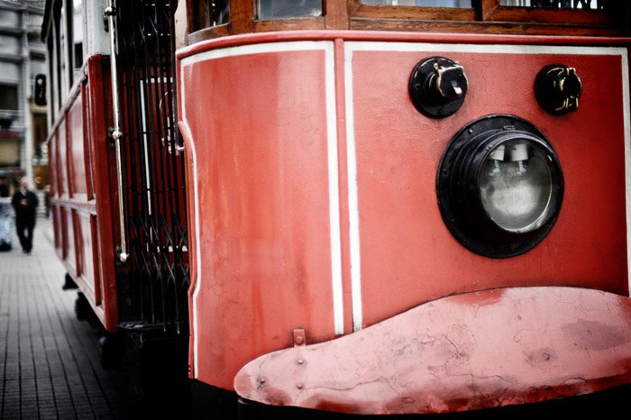 A grunge photography shot of a red tram