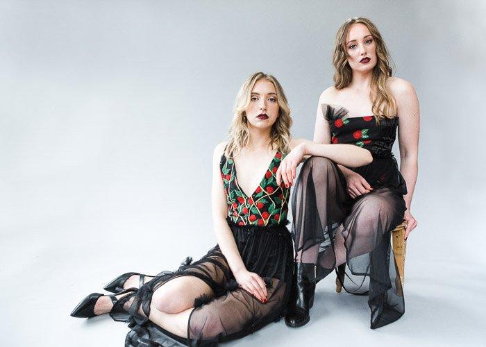 A studio portrait of two female models - photography studio equipment