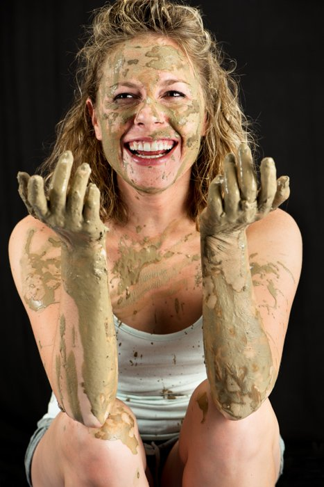 A studio portrait of a female model covered in ceramic clay - photography lighting mistakes