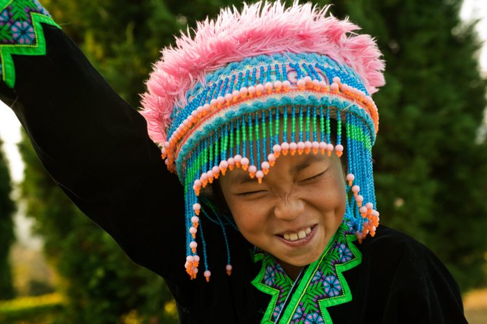 A fun portrait of a young Hmong Hill Tribe Girl - portrait lighting tips