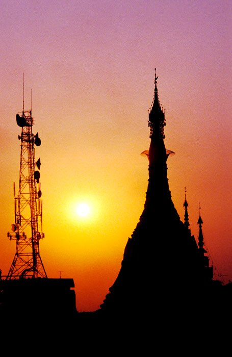The silhouette of a pagoda against a beautiful sunset