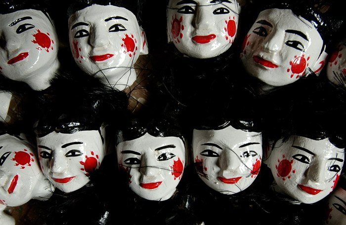 Overhead view of painted doll heads