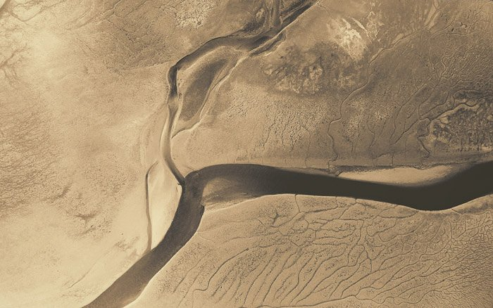 A stunning abstract aerial landscape photography shot of a desert landscape