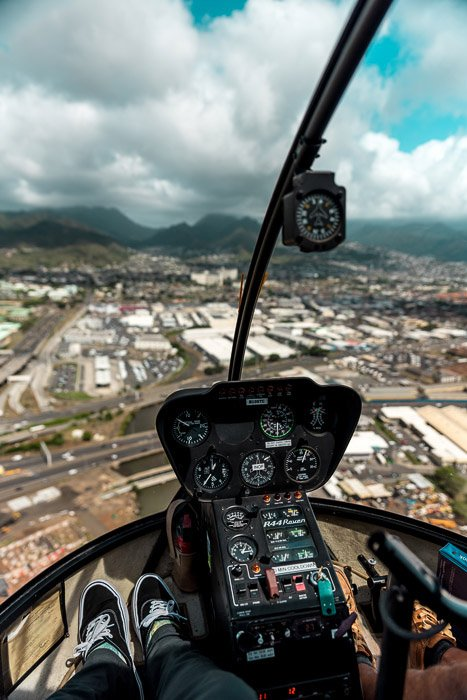 A view from the interior of a helicopter in mid flight