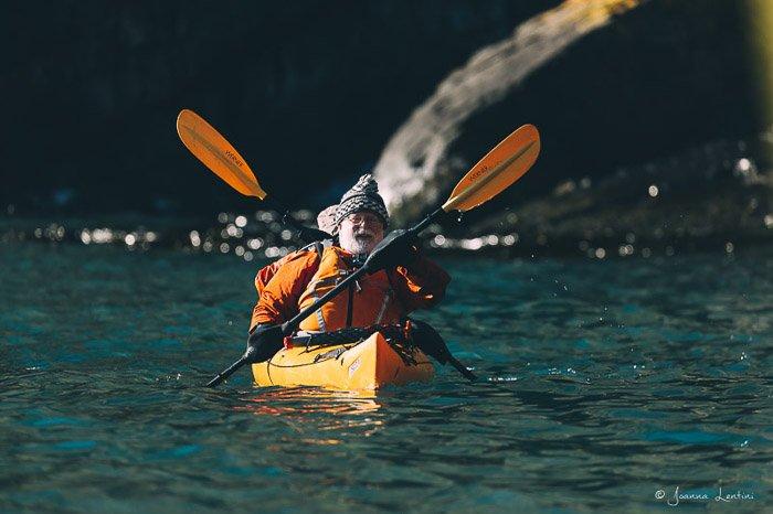 Two men rowing through a river - adventure photography gear