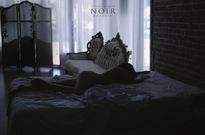 A dark and moody boudoir photography setup
