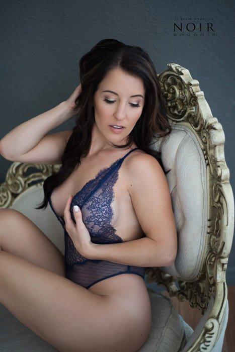 A professional boudoir portarit of a female model posing in lingerie