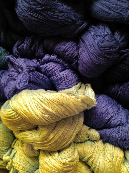 Yellow and purple balls of wool