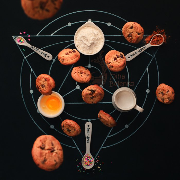 Alchemy themed food flatlay including coffee cups, chalk drawings, sugar sprinkles and cookies