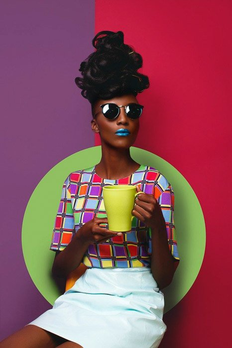 A brightly colored fashion shoot setup for a portrait of a female model by Victor Peace