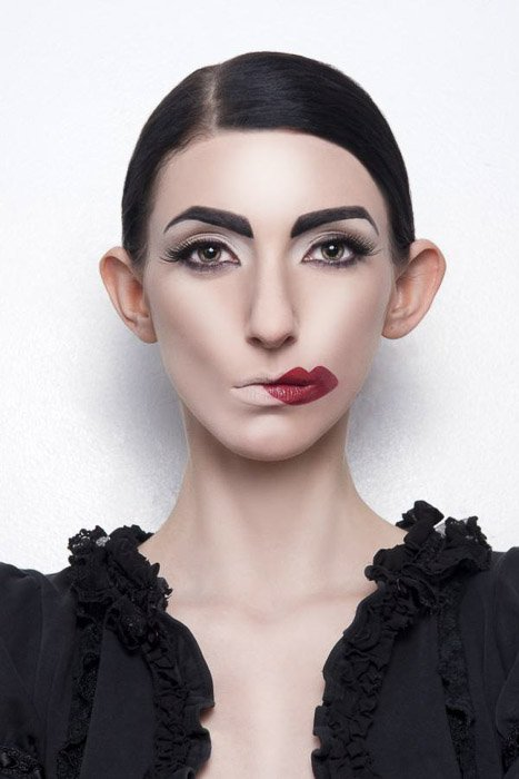 Striking portrait of a female model with humorous lipstick by Ransom Rockwood - -fashion photography ideas