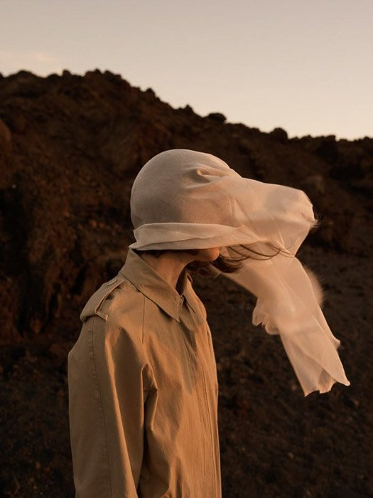 photo by Emma Tempest of a fashion model whose face is covered by a scarf