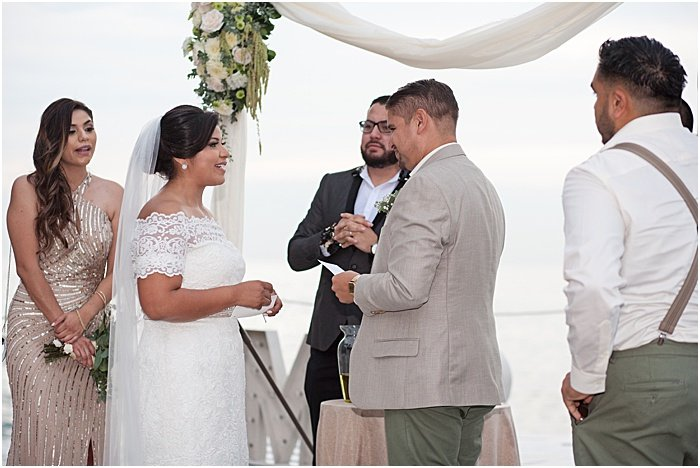 A wedding portrait of the couple being married in an outdoor reception - wedding flash photography