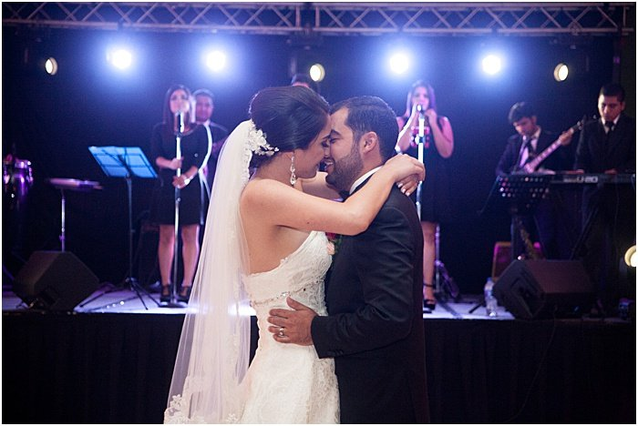 A wedding portrait of the couple dancing indoors - wedding flash photography