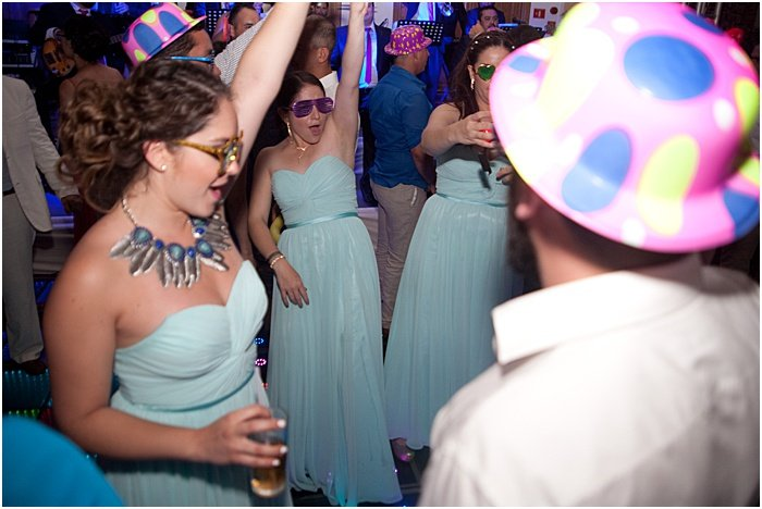 A candid wedding photo of guests dancing - wedding flash photography