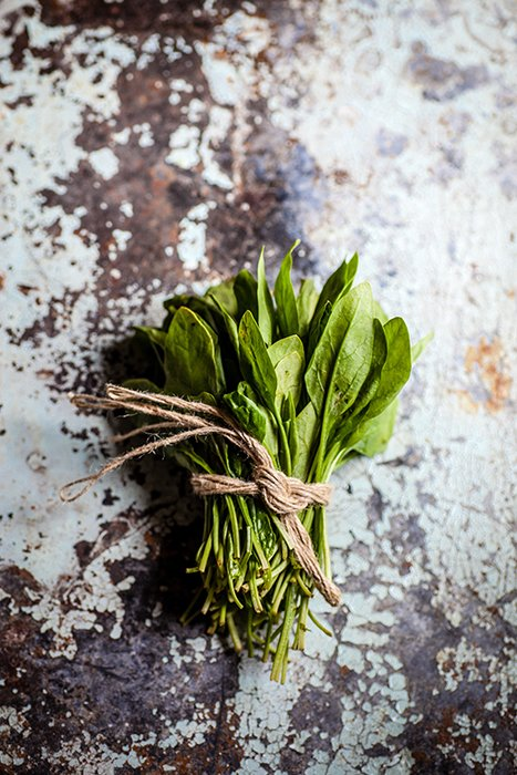 A bunch of salad leaves wrapped in twine - form in food photography