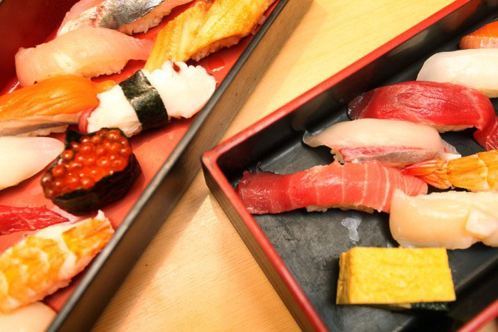A close up food photo of plates of sushi