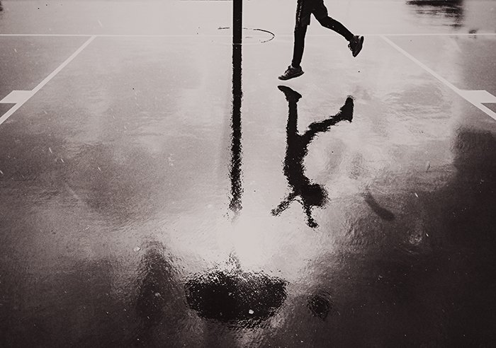 Reflection of a kid playing.