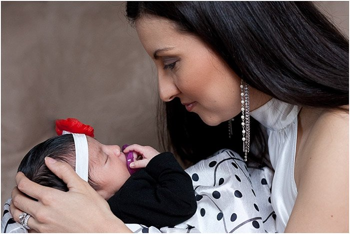 Sweet portrait of a mother holding a newborn baby - newborn photography mistakes to avoid