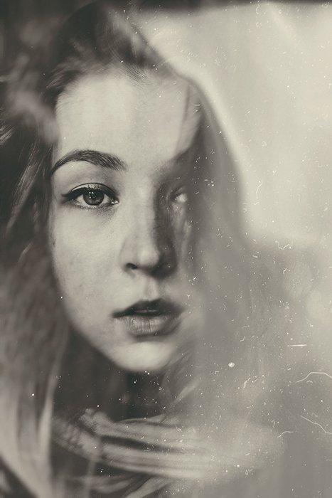 Grainy film noir photography portrait of a female model in monochrome