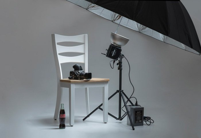 photoshoot set up in a studio with a photography umbrella