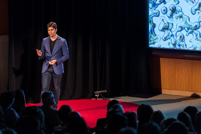 A public speaker onstage talking about how to make money with photography