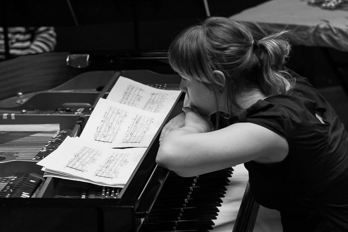 A black and white photo of a pianist onstage - stage photography tips