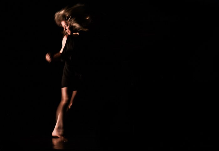 A portrait of a performer moving onstage - stage photography tips