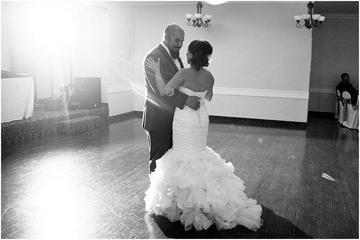 A monochrome wedding portrait of the couple dancing - wedding flash photography