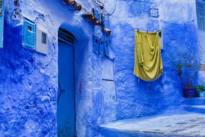 Chefchaouen, a Moroccan city filled with bright blue buildings - vibrant colorful photography