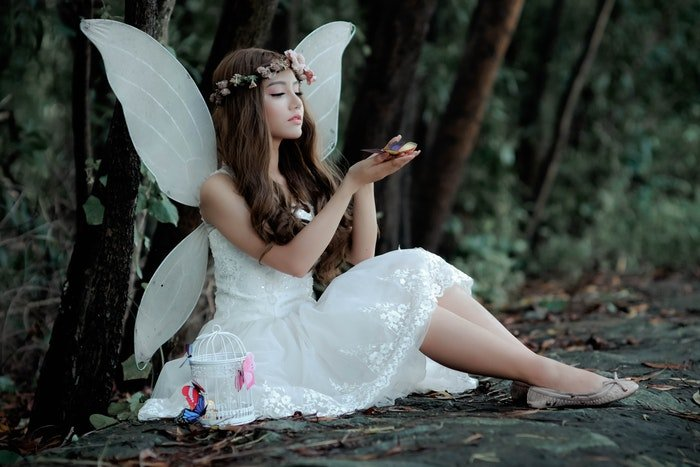 Woman in a fairy costume in the woods
