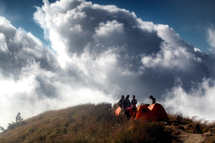 A group of people at a campsite during an adventure photography trip
