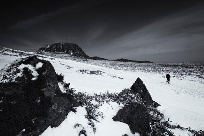 A hiker walking through a stunning snowy landscape