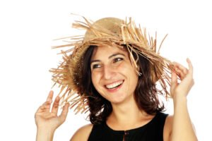 Smiling woman wearing a straw hat
