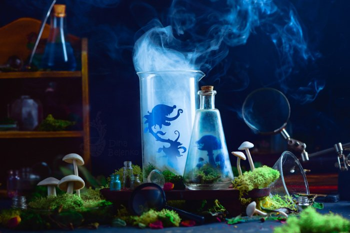 A creative still life featuring a spooky scientific experiment with smoke and silhouettes