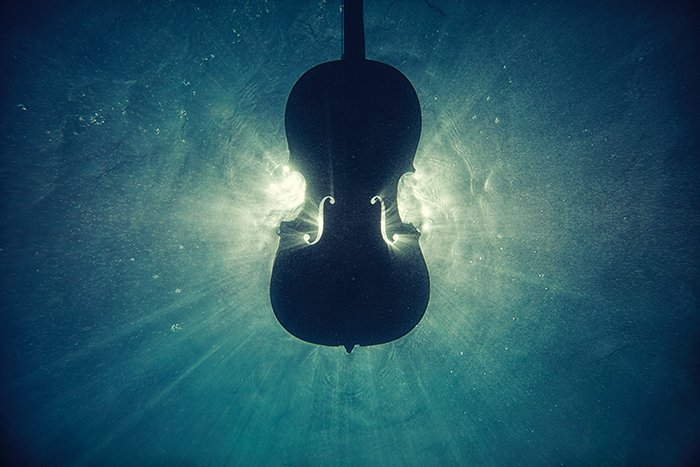 Atmospheric photo of a cello underwater - beautiful photography principles