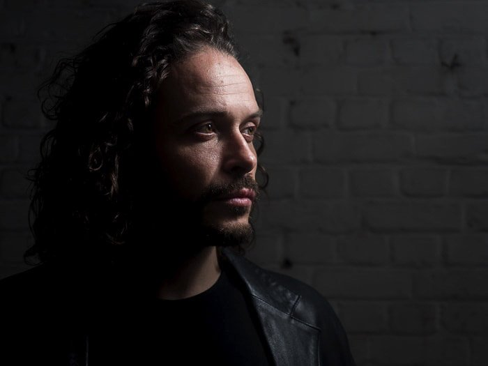 Studio portrait of a male model shot with short lighting techniques