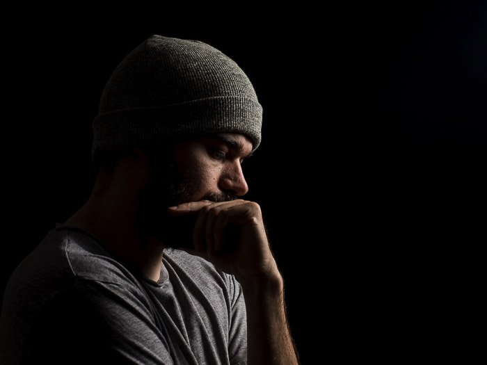 atmospheric portrait of a male model shot with short lighting techniques