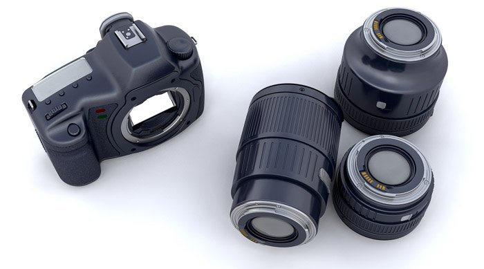 Overhead view of a camera body and three lenses