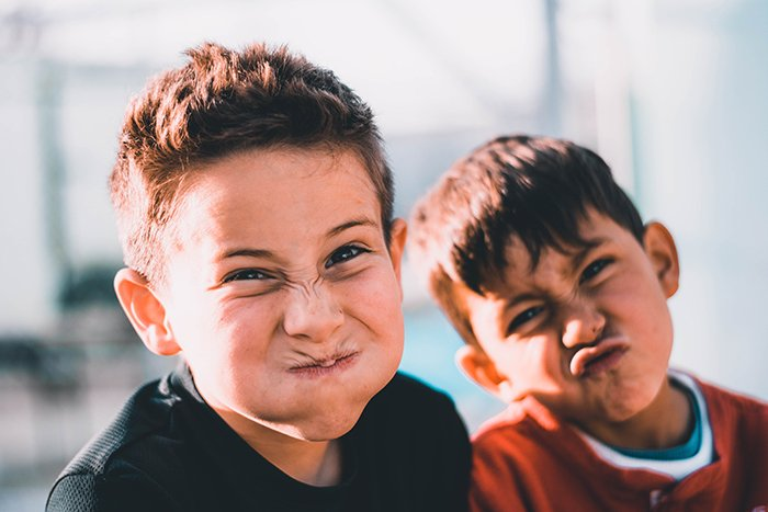 A fun portrait of two young boys making silly faces - friendship images