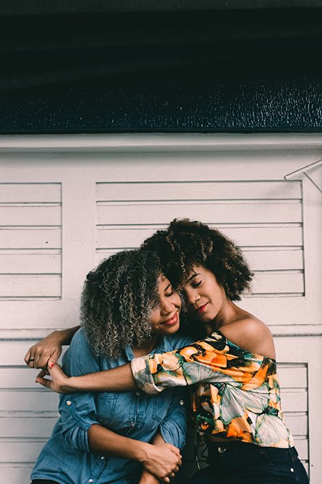 A sweet best friend photoshoot of two females embracing