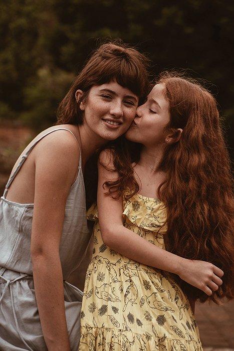 A sweet outdoor portrait of two female friends posing lovingly - best friend photoshoots