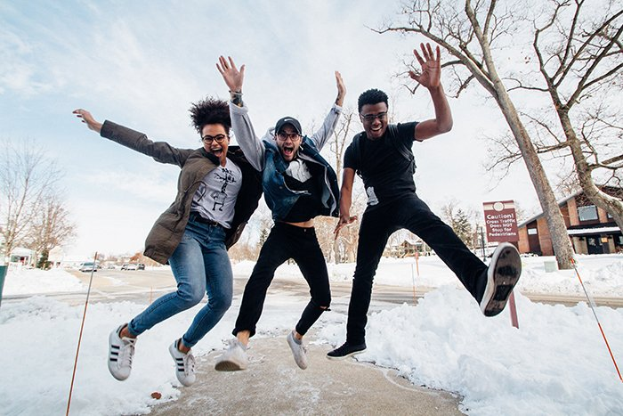 A fun outdoor portrait of three friends jumping - best friend photoshoots