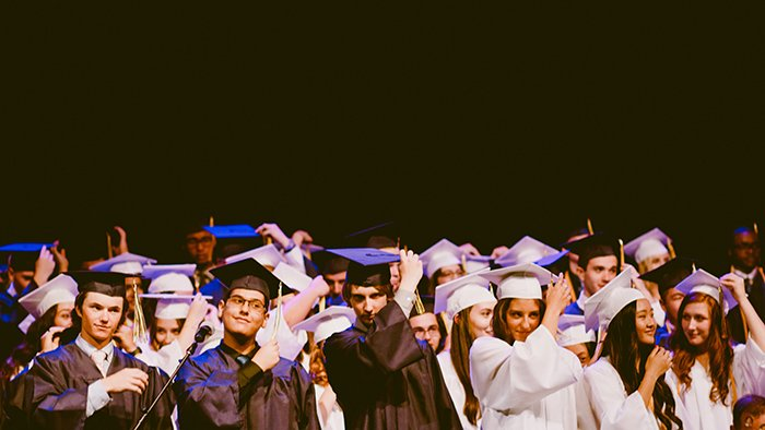 Indoor portarit of a large group of graduation students