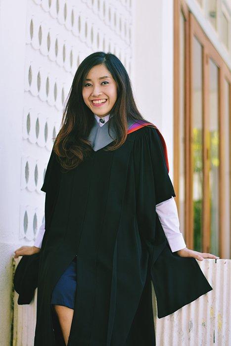 Beautiful graduation portrait of a female student posing outdoors