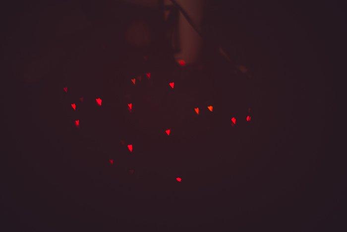 pretty heart shaped bokeh lights on dark background